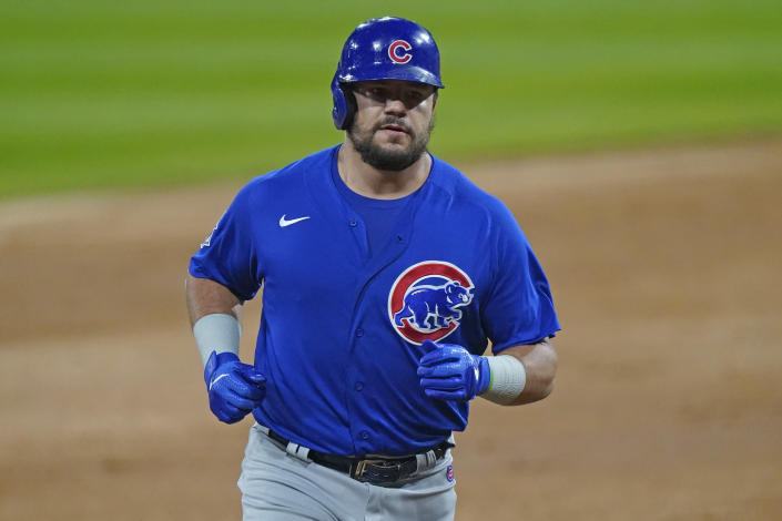 Chicago Cubs' Kyle Schwarber rounds the bases after hitting a solo home run against the Chicago White Sox during the second inning of a baseball game in Chicago, Friday, Sept. 25, 2020. (AP Photo/Nam Y. Huh)