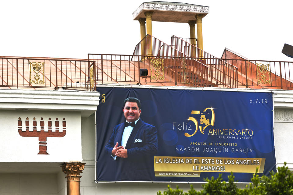 Mexico-based megachurch La Luz del Mundo, leader and self-proclaimed apostle Naasón Joaquín García's 50 birthday celebration portrait, is displayed on the side of the East Los Angeles temple on Friday, June 7, 2019. On Tuesday, April 7, 2020 a California appeals court dismissed the criminal case against the Mexican megachurch leader on charges of child rape and human trafficking. The case was dismissed on procedural grounds. García, the self-proclaimed apostle of La Luz del Mundo, has been in custody since June. He is currently being held without bail in Los Angeles. The attorney general's office said it was reviewing the court's ruling. (AP Photo/Damian Dovarganes)