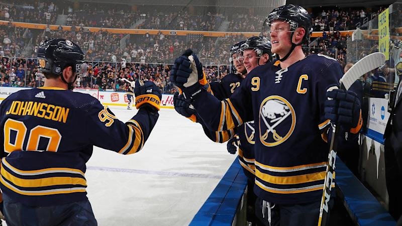BUFFALO, NY - OCTOBER 14: Marcus Johansson #90 of the Buffalo Sabres celebrates his third period goal at the bench with Jack Eichel #9 during an NHL game against the Dallas Stars on October 14, 2019 at KeyBank Center in Buffalo, New York. (Photo by Bill Wippert/NHLI via Getty Images)