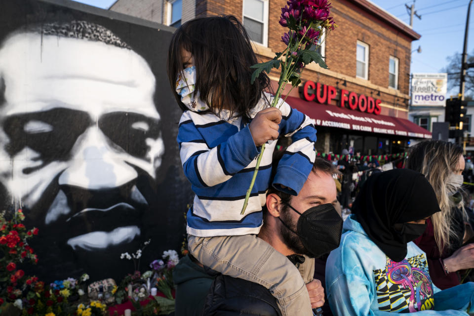 Demonstrators gather outside Cup Foods to celebrate the murder conviction of former Minneapolis police Officer Derek Chauvin in the killing of George Floyd, Tuesday, April 20, 2021, in Minneapolis. (AP Photo/John Minchillo)