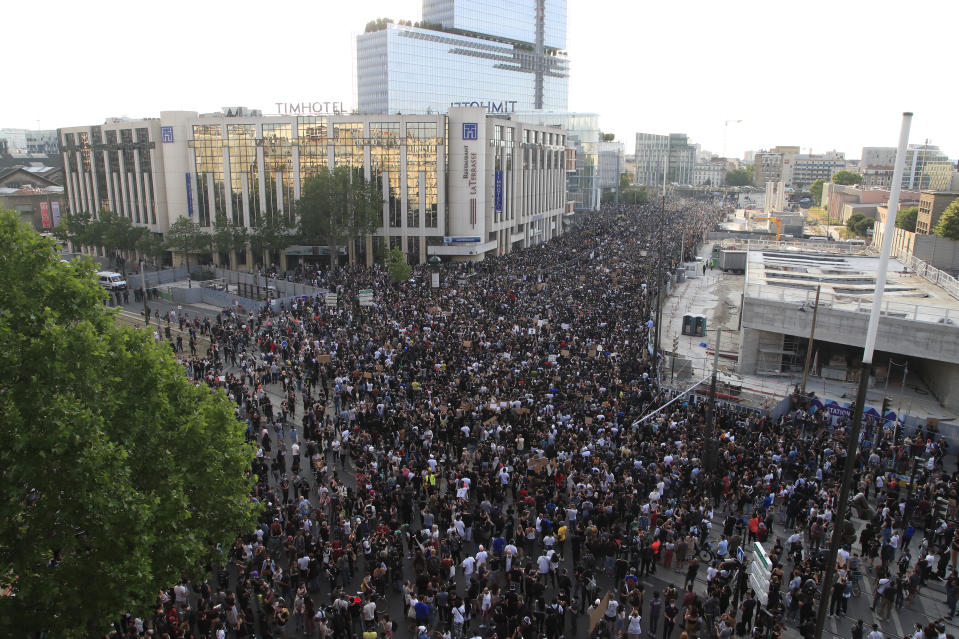 Protesters gather Tuesday, June 2, 2020 in Paris. Thousands of people defied a police ban and converged on the main Paris courthouse for a demonstration to show solidarity with U.S. protesters and denounce the death of a black man in French police custody. The demonstration was organized to honor Frenchman Adama Traore, who died shortly after his arrest in 2016, and in solidarity with Americans demonstrating against George Floyd's death. (AP Photo/Michel Euler)