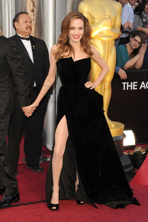 """<b>Oscars 2012: Angelina's right leg goes viral</b><br><br>Angelina Jolie's right leg quickly became the most interesting thing about this year's Oscars. She made headlines with her over-the-top pose on that she displayed on the red carpet AND on the presenting stage.<br><br> Her antics certainly haven't gone unnoticed on the internet with viral images of her leg in odd locations surfacing online.<br><br> Click on to see our pick of the bunch. <br><br><b>[Related gallery: </b><a href=""""http://uk.movies.yahoo.com/photos/oscars-2012-red-carpet-photos-1330099441-slideshow/"""" data-ylk=""""slk:Oscars 2012: All the red carpet photos;outcm:mb_qualified_link;_E:mb_qualified_link;ct:story;"""" class=""""link rapid-noclick-resp yahoo-link""""><b>Oscars 2012: All the red carpet photos</b></a><b>]</b>"""