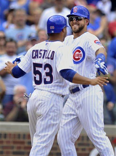 Chicago Cubs' Brett Jackson right, celebrates with Welington Castillo after hitting a two-run home run against the Colorado Rockies in the fourth inning of a baseball game in Chicago, Saturday, Aug. 25, 2012. Colorado won 4-3. (AP Photo/Paul Beaty)