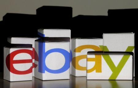 "An eBay logo is projected onto white boxes in this illustration picture taken in Warsaw, January 21, 2014.  REUTERS/Kacper Pempel/File Photo   GLOBAL BUSINESS WEEK AHEAD PACKAGE - SEARCH ""BUSINESS WEEK AHEAD JULY 18"" FOR ALL IMAGES - RTSIG1E"