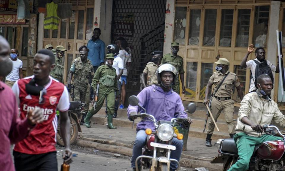Security forces patrol a street in Kampala after protests over the arrest of Bobi Wine.