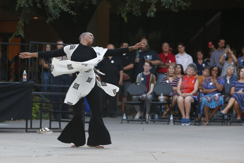 Dancer Maisha Morris dances during a memorial prayer service, Sunday, Sept. 1, 2019, in Odessa, Texas, for the victims of a shooting spree the day before. (AP Photo/Sue Ogrocki)