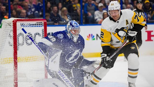 Tampa Bay Lightning goaltender Andrei Vasilevskiy preserved the 3-2 victory over the Pittsburgh Penguins with a jaw-dropping stop as the clock expired. (Mark LoMoglio/NHLI via Getty Images)
