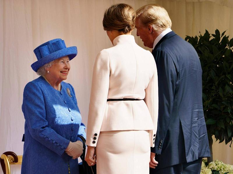 The Queen was left to welcome President Trump and first lady Melania alone while senior royals attended other engagements (AFP/Getty Images)