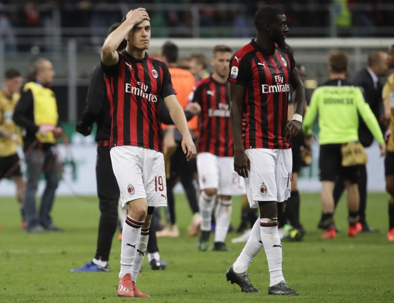 AC Milan's Krzysztof Piatek, left, and Tiemoue Bakayoko walks off the pitch at the end of the Serie A soccer match between AC Milan and Udinese, at the San Siro stadium in Milan, Italy, Tuesday, April 2, 2019. (AP Photo/Luca Bruno)