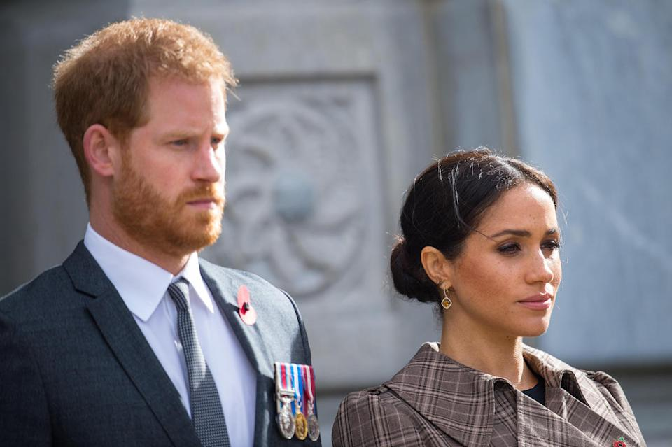 Prince Harry, Duke of Sussex and Meghan, Duchess of Sussex lay ferns and a wreath at the tomb of the Unknown Warrior while they visit the newly unveiled UK war memorial and Pukeahu National War Memorial Park on October 28, 2018, in Wellington, New Zealand.