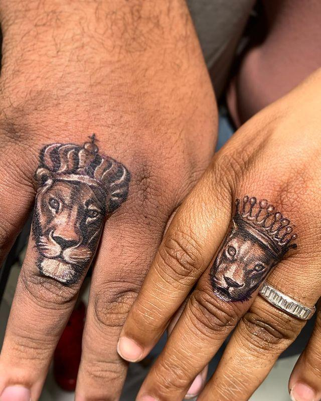 """<p>What better way to match your S.O. than with ring finger tattoos? These his-and-her lions are a clever way to make it known that you are each other's king and queen.</p><p><a href=""""https://www.instagram.com/p/B6ZoLu1h0ZU/?utm_source=ig_embed&utm_campaign=loading"""" rel=""""nofollow noopener"""" target=""""_blank"""" data-ylk=""""slk:See the original post on Instagram"""" class=""""link rapid-noclick-resp"""">See the original post on Instagram</a></p>"""
