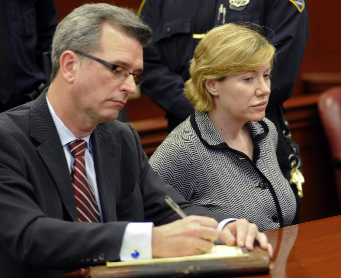 Anna Gristina, who has been charged with promoting prostitution, appears in State Supreme Court with her attorney Peter Gleason, Monday, March 12, 2012, in New York. A judge is expected to examine her finances to see whether she should continue to get a court-paid defense. (AP Photo/Louis Lanzano)