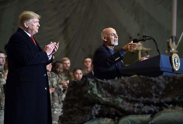 PHOTO: Afghan's President Ashraf Ghani speaks to the troops as President Donald Trump listens during a surprise Thanksgiving day visit at Bagram Air Field, Nov. 28, 2019, in Afghanistan. (Olivier Douliery/AFP via Getty Images)