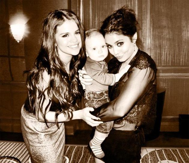 "Celebrity Twitpics: Selena Gomez tweeted an adorable snap of herself with Vanessa Hudgens and a baby on the set of their latest movie. She tweeted it alongside the caption: ""Not a bad day in the office."""