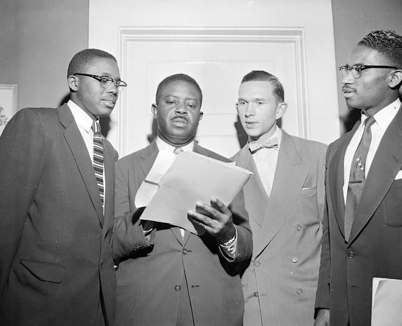 The Rev. Ralph D. Abernathy, center, speaks with attorney Fred D. Gray and the Rev. Robert S. Graetz about the bus boycott settlement in Montgomery on Feb. 21, 1956. Rev. Ralph D. Abernathy, center, speaks with attorney Fred D. Gray, left, and the Rev. Robert S. Graetz, right of Abernathy, about the bus boycott settlement in Montgomery, Ala., on Feb. 21, 1956. (AP Photo)
