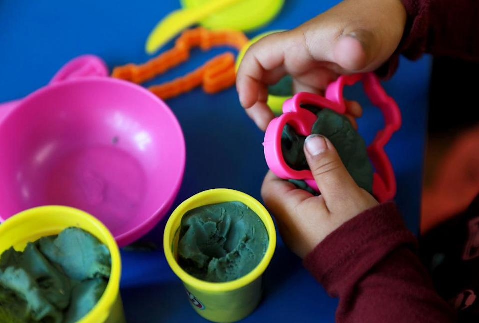 Kid playing with Play-Doh