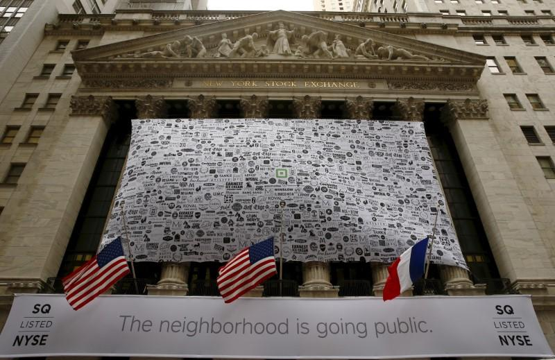 Signage for Square Inc. covers the front of the New York Stock Exchange celebrating the company's IPO