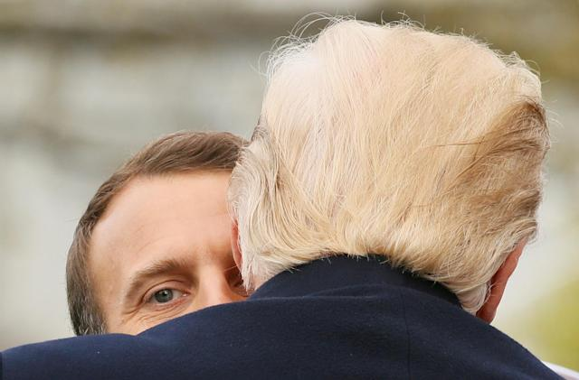 <p>U.S. President Donald Trump and French President Emmanuel Macron hug during an arrival ceremony at the White House in Washington, U.S., April 24, 2018. (Photo: Jim Bourg/Reuters) </p>