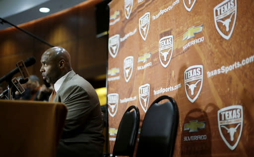 Charlie Strong answers questions during an NCAA college football news conference where he was introduced as the new Texas football coach, Monday, Jan. 6, 2014, in Austin, Texas. Strong replaces Mack Brown, who coached Texas for 16 years and won the 2005 national championship. (AP Photo/Eric Gay)