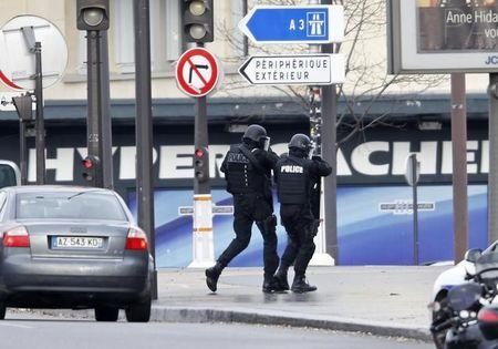 French intervention police are seen at the scene of a hostage taking at a kosher supermarket in eastern Paris