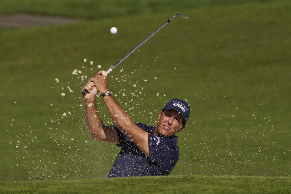 Phil Mickelson chips to the second green during the third round of the Masters golf tournament Saturday, Nov. 14, 2020, in Augusta, Ga. (AP Photo/Chris Carlson)