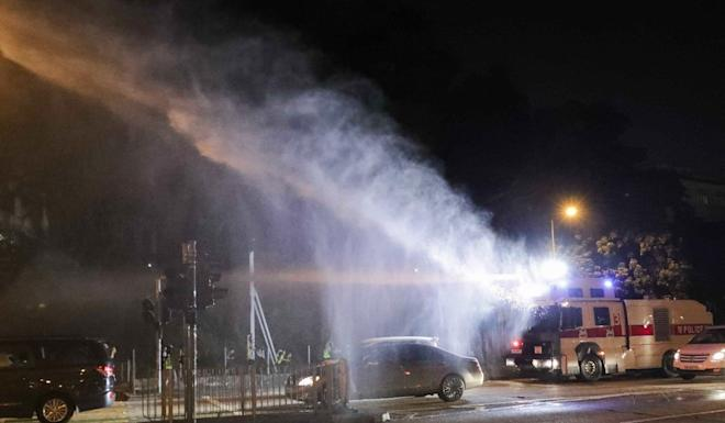 Police use water cannon to disperse protesters on Chatham Road in Tsim Sha Tsui. Photo: Edmond So