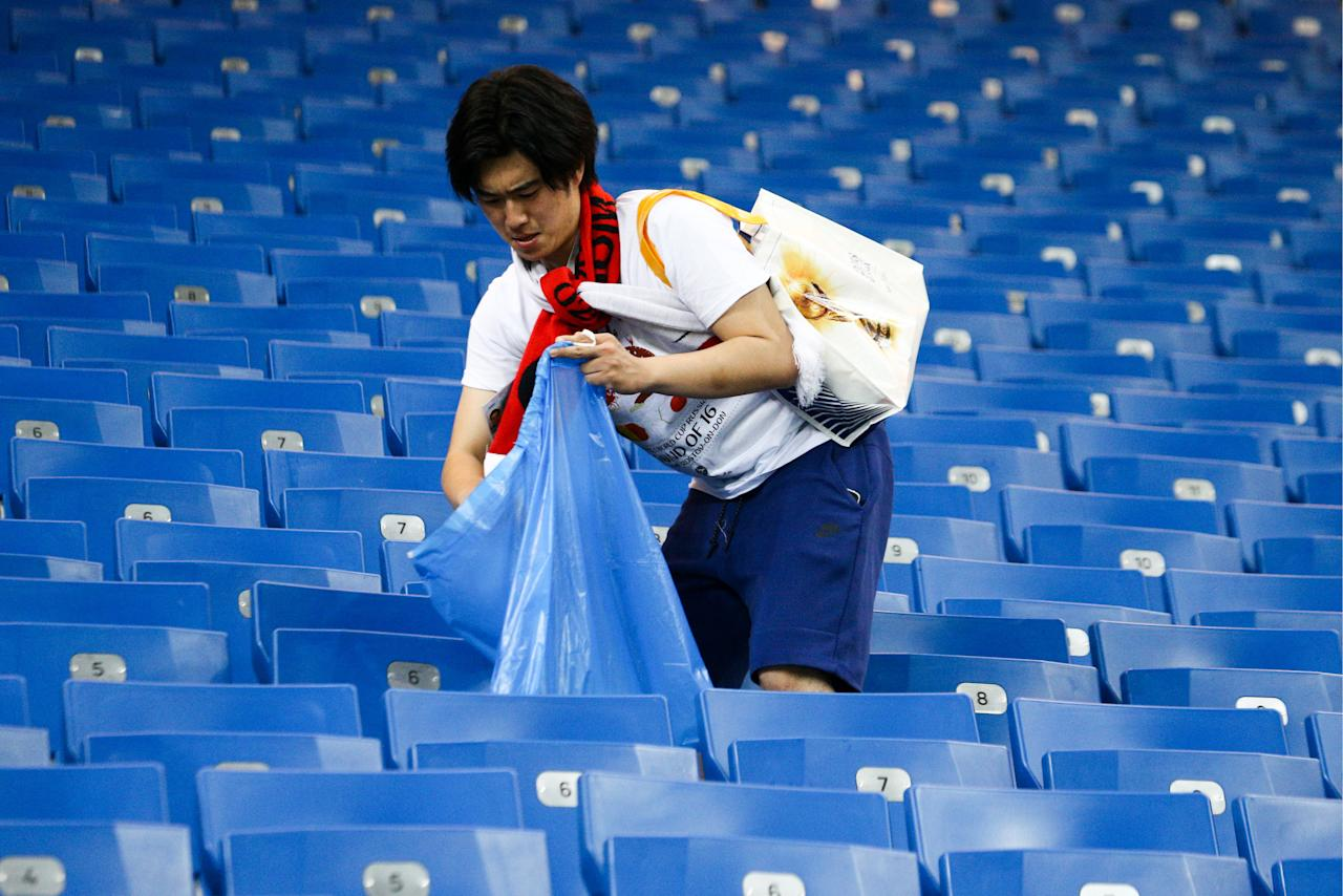 <p>Japan's supporter collecting rubbish after their 2018 FIFA World Cup Round of 16 football match against Belgium at Rostov Arena Stadium. Team Belgium won the game 3:2. Valery Matytsin/TASS (Photo by Valery Matytsin\TASS via Getty Images) </p>