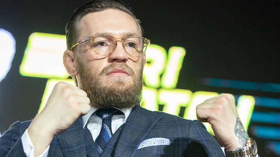 Pictured here, UFC fighter Conor McGregor poses for photos with his fists raised.