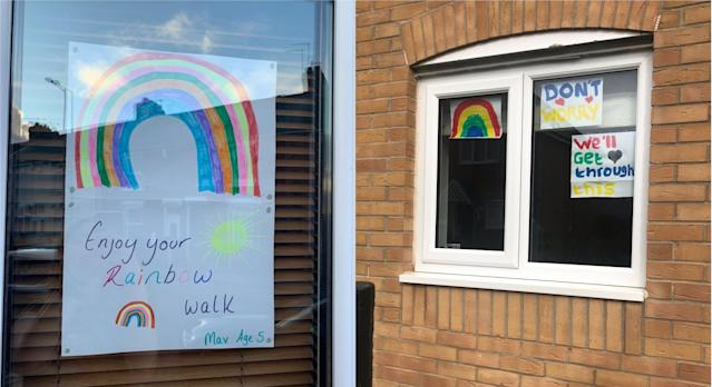Children are painting rainbows to put in their windows to raise the spirits of passers-by (PA)