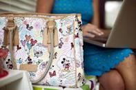 A Disney-themed bag is pictured next to chief executive of California-based social and educational group for parents Club MomMe Rachel Pitzel as she works at her home in Playa Vista, California, June 10, 2015. REUTERS/Mario Anzuoni