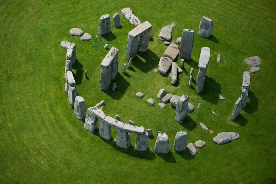"""The true purpose and origin of <a href=""""https://www.cntraveler.com/story/england-might-build-a-traffic-tunnel-under-stonehenge?mbid=synd_yahoo_rss"""" rel=""""nofollow noopener"""" target=""""_blank"""" data-ylk=""""slk:Stonehenge"""" class=""""link rapid-noclick-resp"""">Stonehenge</a> remains a contested mystery: Theories range from the legendary Welsh wizard Merlin having transported the rocks from Ireland, to the stone circle being a model for female fertility, to a calendar used for seasonal rituals, and an astronomical prediction tool for phenomena like <a href=""""https://www.cntraveler.com/gallery/where-to-see-every-total-solar-eclipse-through-2030?mbid=synd_yahoo_rss"""" rel=""""nofollow noopener"""" target=""""_blank"""" data-ylk=""""slk:solar eclipses"""" class=""""link rapid-noclick-resp"""">solar eclipses</a>. Regardless, the spiritual landmark remains one of the U.K.'s most popular attractions, drawing some 800,000 visitors annually. There are ties to Druidic and pagan culture, too, and some groups of them still gather at the site to celebrate equinoxes and solstices. To visit, you can take a day trip from <a href=""""https://www.cntraveler.com/gallery/best-things-to-do-in-london?mbid=synd_yahoo_rss"""" rel=""""nofollow noopener"""" target=""""_blank"""" data-ylk=""""slk:London"""" class=""""link rapid-noclick-resp"""">London</a>—about two and a half hours by bus."""