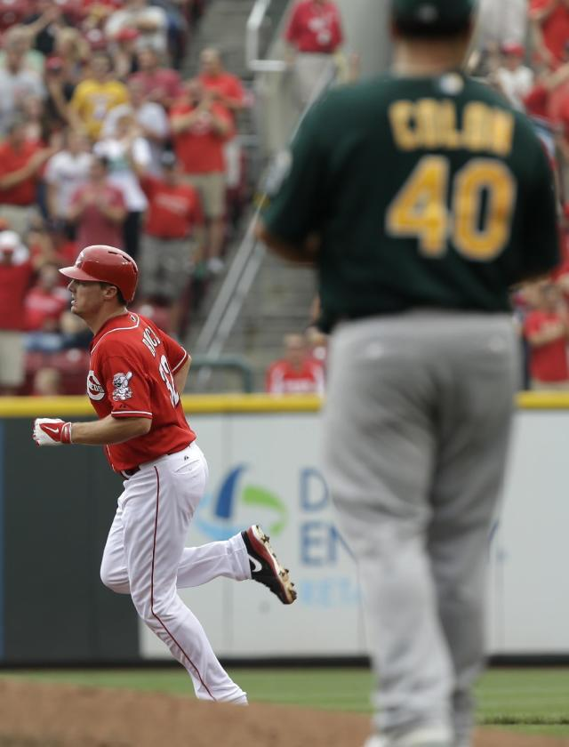 Cincinnati Reds' Jay Bruce rounds the bases after hitting a two-run home run off Oakland Athletics starting pitcher Bartolo Colon (40) in the third inning of a baseball game, Wednesday, Aug. 7, 2013, in Cincinnati. (AP Photo/Al Behrman)