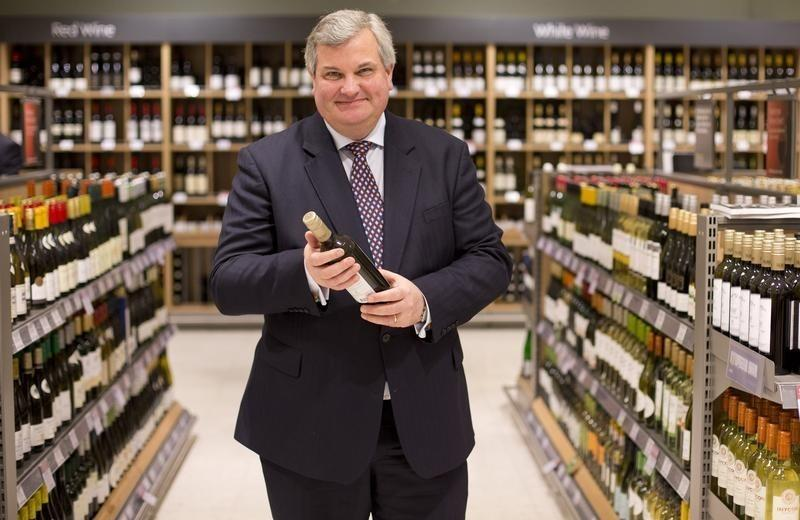 Managing Director of Waitrose Mark Price poses for photographs in the  Canary Wharf store of the