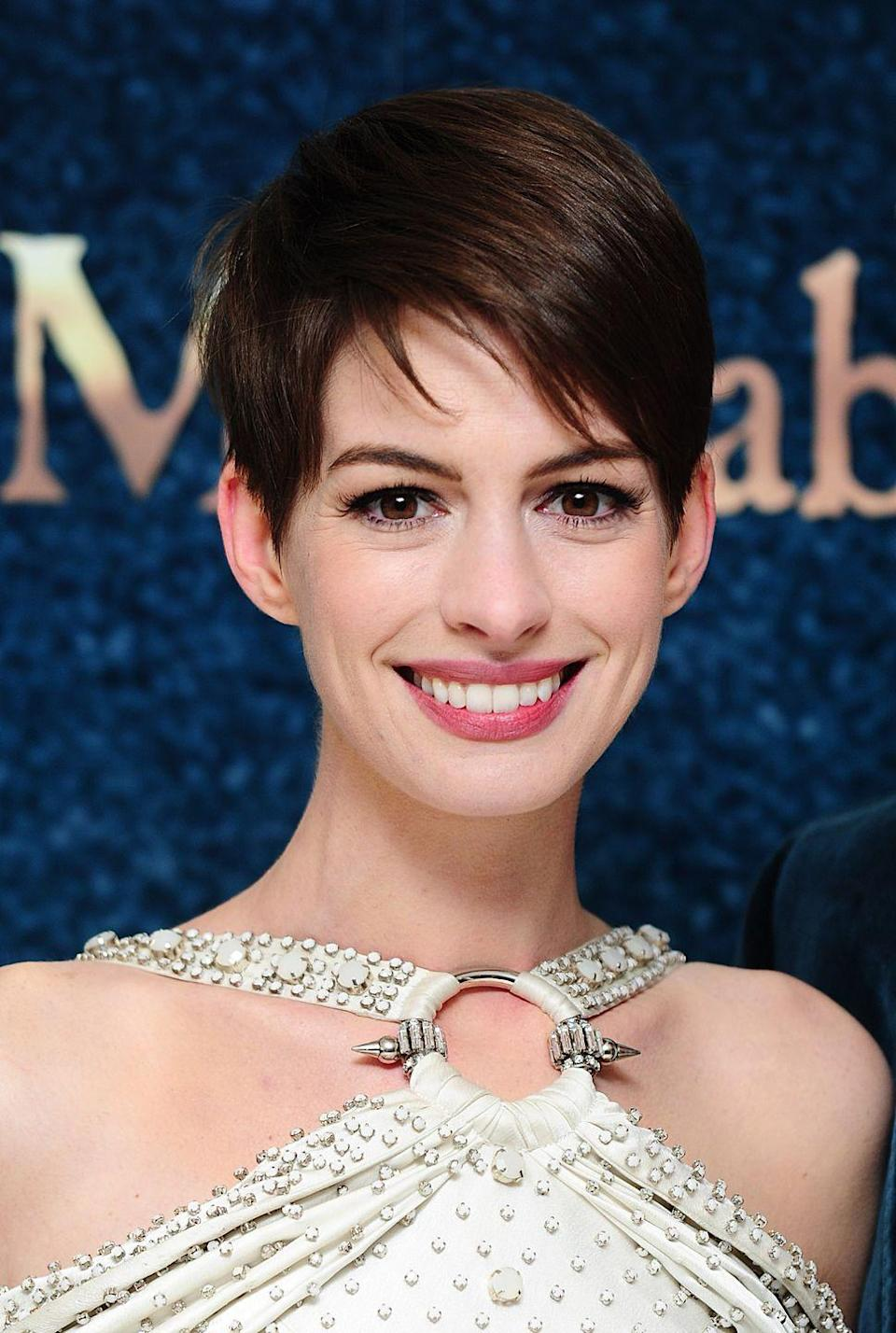 <p>Yes, that's Anne Hathaway in a pixie cut. The actress shaved her head for her role in <em>Les Misérables </em>and spent awards season (she won the Academy Award for Best Actress that year) sporting the shorter look.</p>