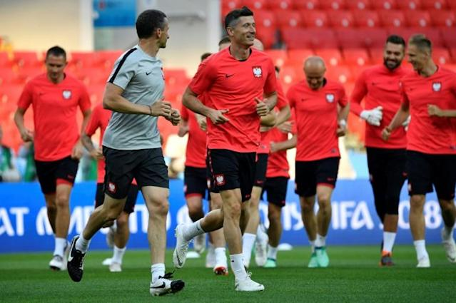 Eighth-ranked Poland enter their Group H opener at Moscow's Spartak Stadium as favourites against Senegal led by Bayern Munich's Robert Lewandowski (C)