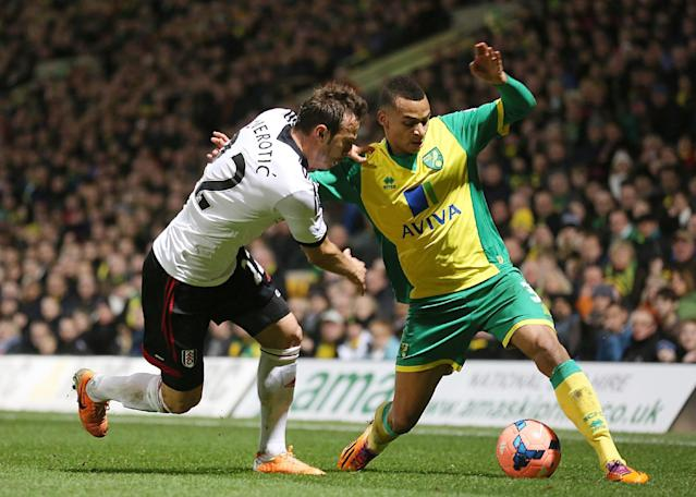 Norwich City's Josh Murphy, right, and Fulham's Elsad Zverotic battle for the ball during their FA Cup third round soccer match at Carrow Road, Norwich, England, Saturday, Jan. 4, 2014. (AP Photo/Chris Radburn, PA Wire)