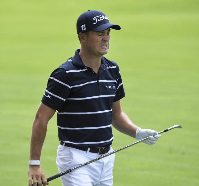 Justin Thomas reacts to his fairway shot on the 17th hole during the first round of the BMW Championship golf tournament at Medinah Country Club, Thursday, Aug. 15, 2019, in Medinah, Ill. (John Starks/Daily Herald via AP)