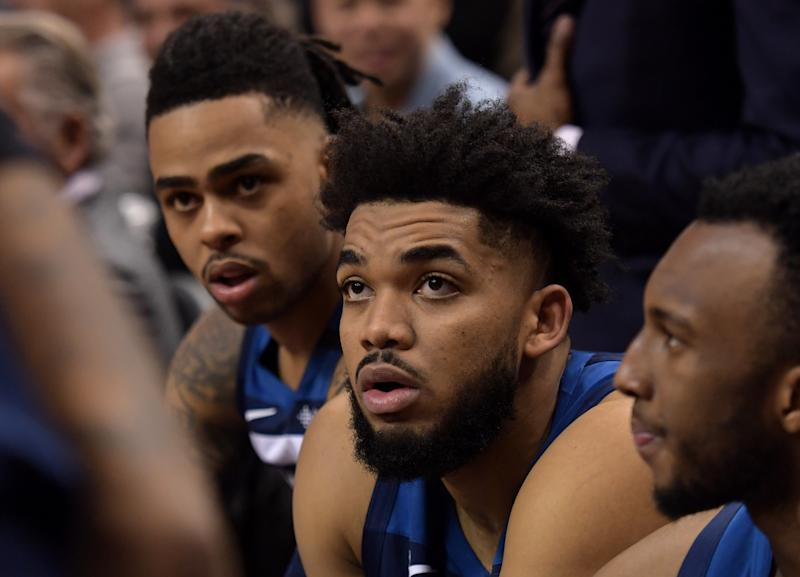 The Karl Anthony-Towns-DeAngelo Russell experiment has been put on hold. (Dan Hamilton/Reuters)