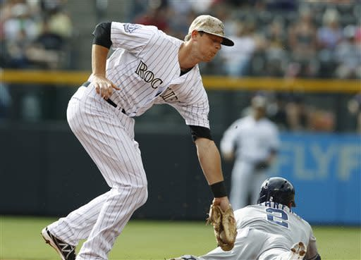 Colorado Rockies second baseman DJ LeMahieu, left, applies a late tag to San Diego Padres' Everth Cabrera who steals second base in the first inning of a baseball game in Denver, Saturday, June 8, 2013. (AP Photo/David Zalubowski)