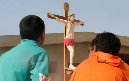 Christian children who left from Al-Arish city North Sinai's Governorate capital after the escalation of a campaign targeting Christians by Islamic State militants last week, look at scale model of Christ after arriving at the Saint Church in Ismailia, northeast of Cairo, Egypt February 27, 2017. Picture taken February 27, 2017. REUTERS/Amr Abdallah Dalsh