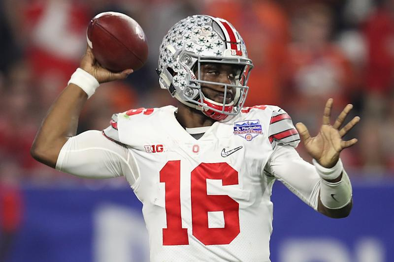 GLENDALE, AZ - DECEMBER 31: J.T. Barrett #16 of the Ohio State Buckeyes throws a pass against the Clemson Tigers during the 2016 PlayStation Fiesta Bowl at University of Phoenix Stadium on December 31, 2016 in Glendale, Arizona. (Photo by Matthew Stockman/Getty Images)