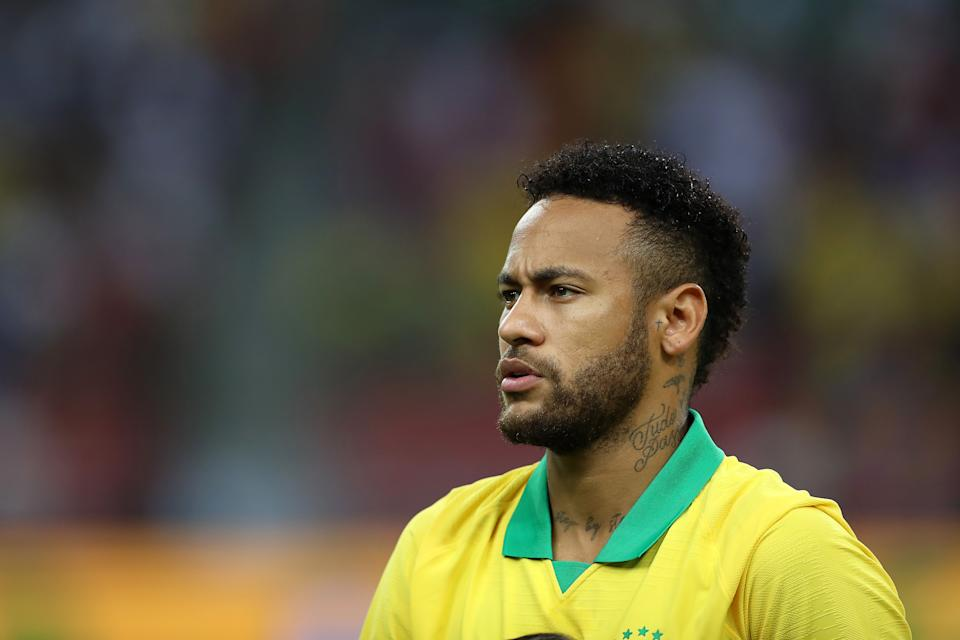 SINGAPORE, SINGAPORE - OCTOBER 13: Neymar Jr of Brazil at the national anthem during the international friendly match between Brazil and Nigeria at the Singapore National Stadium on October 13, 2019 in Singapore. (Photo by Lionel Ng/Getty Images)