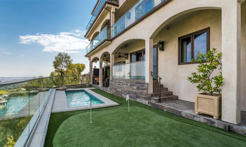 """The three-story spot holds three bedrooms, five bathrooms, a recording studio, barbershop, putting green and pool. <span class=""""copyright"""">(Hilton & Hyland)</span>"""