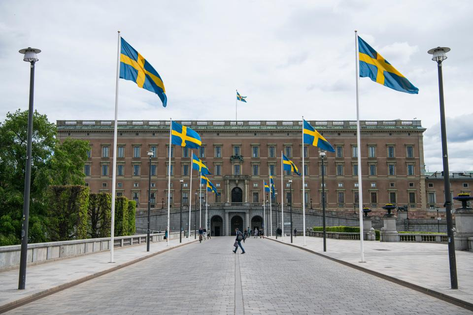 Swedish flags fly in front of the Royal Palace in Stockholm on May 29, 2020, amid the coronavirus COVID-19 pandemic. - Sweden's two biggest opposition parties called Friday for an independent commission to be appointed within weeks to probe the country's response to the new coronavirus. (Photo by Jonathan NACKSTRAND / AFP) (Photo by JONATHAN NACKSTRAND/AFP via Getty Images)