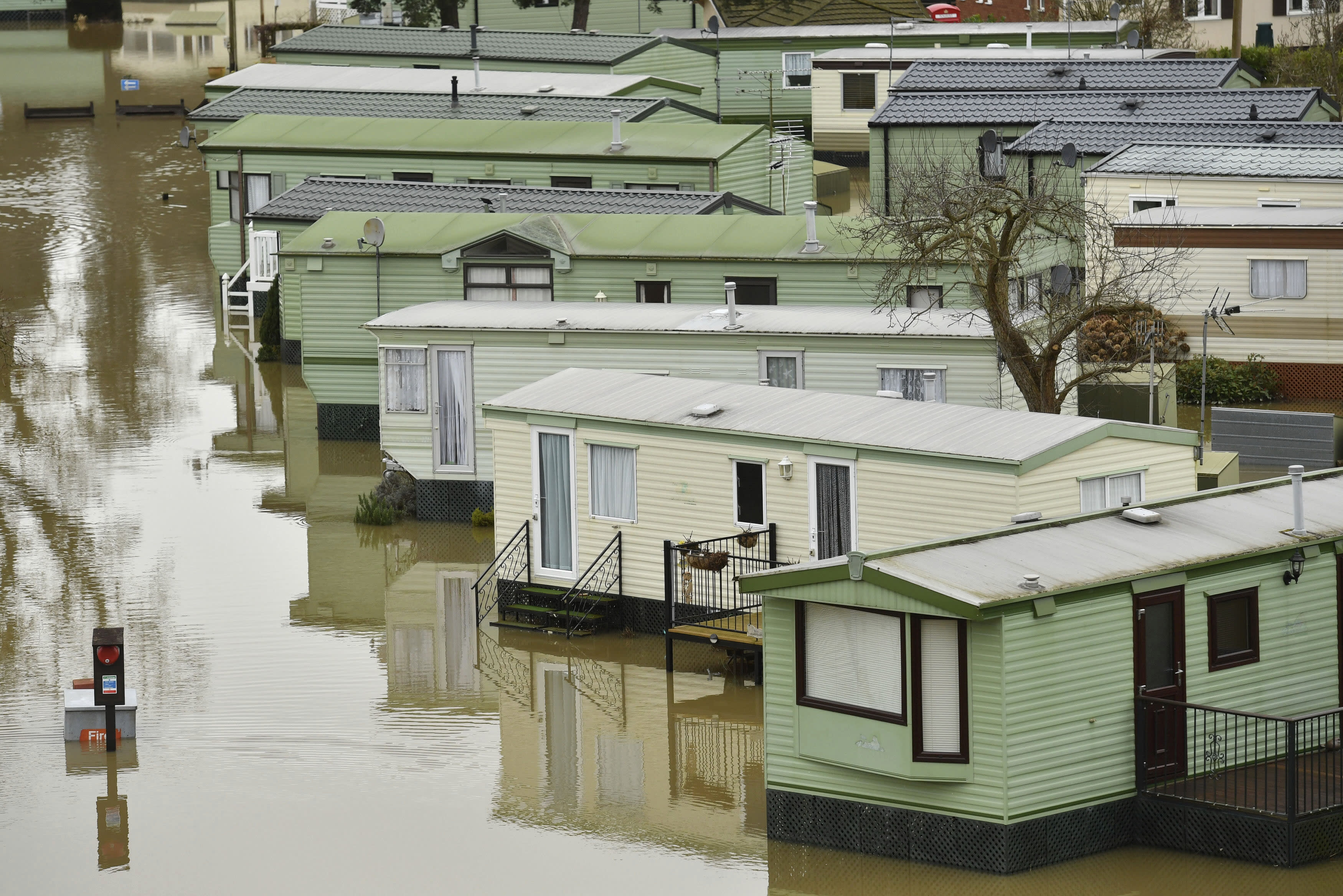The Riverside Caravan Park is inundated by flood water after heavy rains breached the nearby river Severn and normal watercourses in the area of Bridgnorth, England, Wednesday Feb. 19, 2020. Flood-hit communities are braced for further heavy rain as river levels continue to threaten to breach barriers, in the aftermath of Storm Dennis which has swept northern Europe. (Jacob King/PA via AP)