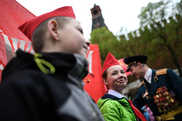 <p>Children take part in a ceremony initiating them into the Young Pioneer Youth communist group in Moscow's Red Square, May 21, 2017. (Photo: Kirill Kudryavtsev/AFP/Getty Images) </p>