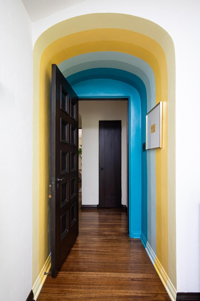 "Hues of teal and yellow were used ""in a sort of ombré way throughout the room,"" says Ferguson."