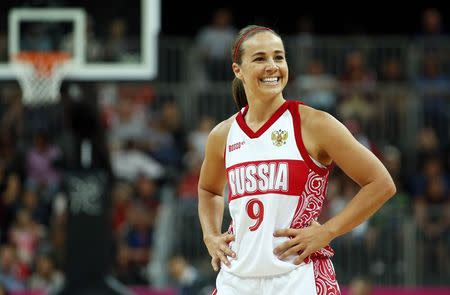 File photo of Russia's Hammon smiles toward her bench during the women's preliminary round Group B basketball match during the London 2012 Olympic Games