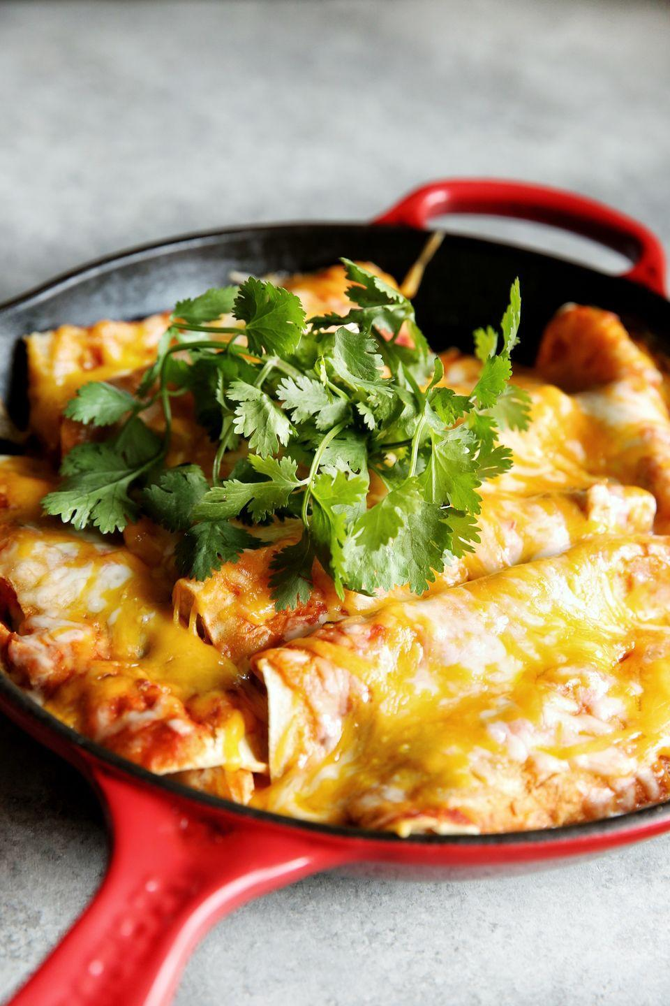 """<p>Make a habit out of these Mexican chicken roll-ups.</p><p>Get the recipe from <a href=""""https://www.delish.com/cooking/recipe-ideas/a49105/cheesy-chicken-enchiladas-recipe/"""" rel=""""nofollow noopener"""" target=""""_blank"""" data-ylk=""""slk:Delish"""" class=""""link rapid-noclick-resp"""">Delish</a>.</p>"""