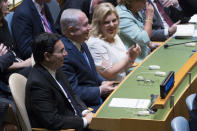 <p>Israeli Prime Minister Benjamin Netanyahu, center, his wife, Sara Netanyahu, and Ambassador to the United Nations Danny Danon listen as President Trump speaks during the 72nd session of the United Nations General Assembly at U.N. headquarters, Tuesday, Sept. 19, 2017. (Photo: Mary Altaffer/AP) </p>